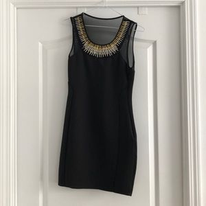 Little black dress with gold and silver neckline